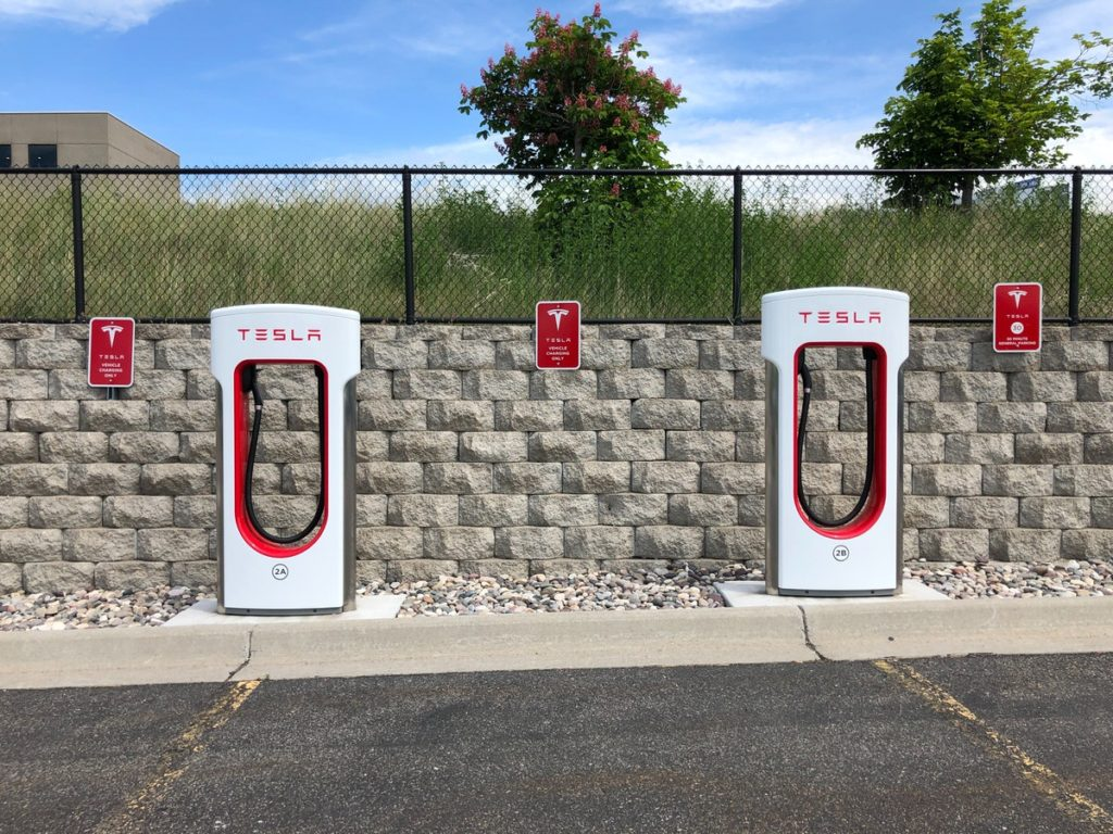 two-white-and-red-tesla-charging-station
